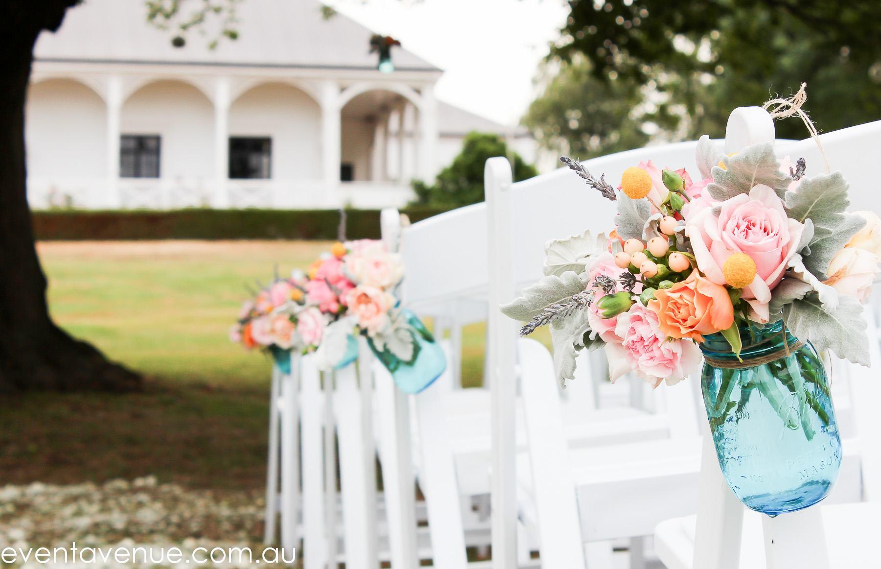 Quamby wedding ceremony blue mason pew jars david austin roses event avenue